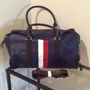NWOT navy with brown handles leather overnight bag
